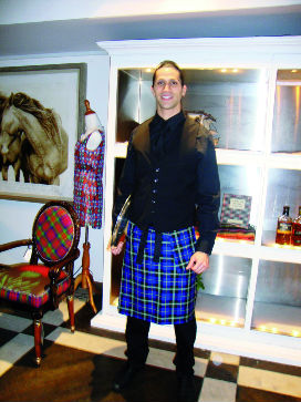 Waiter at Get Kilted in New York wearing Italian National Tartan Kilty Apron from the Clan Italia product range