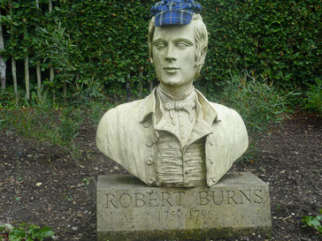 Somebody thought statue of Scotland's world reknowned poet Robert Burns needed an Italian National Tartan cap to keep its head warm