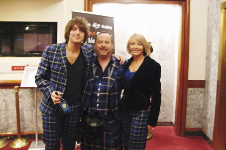 Mike and Annette Lemetti relax with Paolo Nutini after the show at Get Kilted in New York still wearing the Italian National Tartan