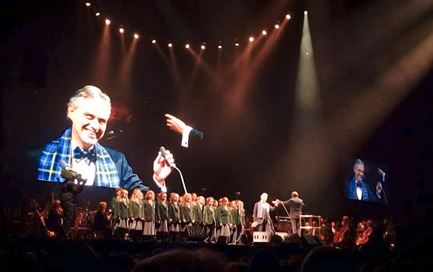 Andrea Bocelli with choir on stage at Glasgow Hydro wearing Italian National Tartan scarf and Bow Tie in November 2013