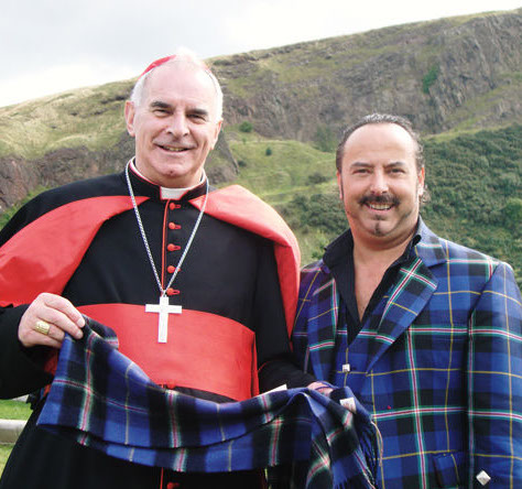 Mike Lemetti of Clan Italia presents Cardinal O'Brien of Glasgow with an Italian National Tatan scarf