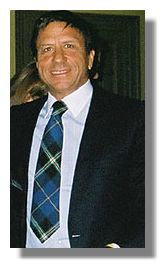 sir Rocco Forte wearing  an Italian National Tartan tie presented to him by Clan Italia
