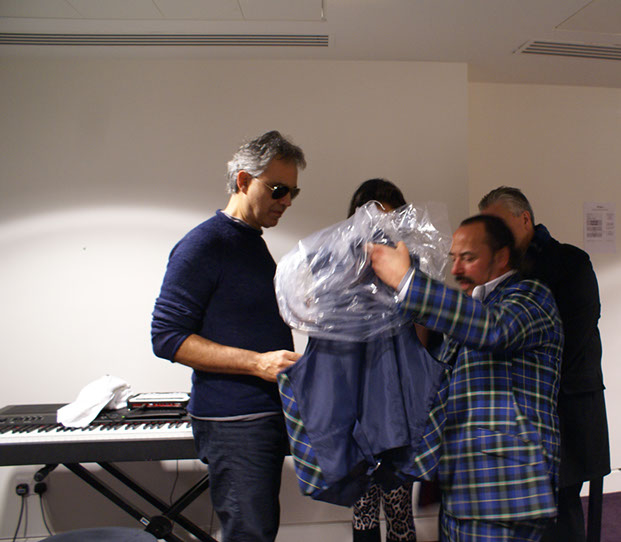 Michael Lemetti presents Andrea Bocelli with Italian National Tartan waiscoat, scarf and bow tie backstage at Glasgow Hydro in Noember 2013
