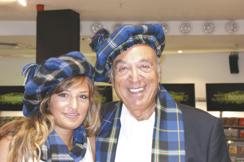 Nicloa Benedetti and her father wearing scarves and bonnets made from the Italian National Tartan presented by Clan Italia