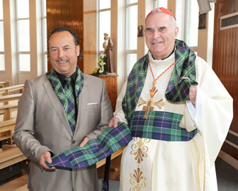 Cardinal O'Brian of Glasgow being presented with scarf and cummerbund made out the St Ninians Day tartan by Clan Italia for the Papal Visit 2010